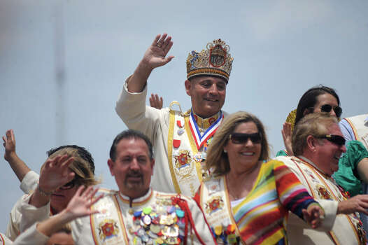 El Rey Feo LXIV Richard Ojeda and his court and friends wave from atop their float during the Battle of Flowers Parade on April 27, 2012. Photo: BILLY CALZADA, Billy Calzada / Express-News / San Antonio Express-News