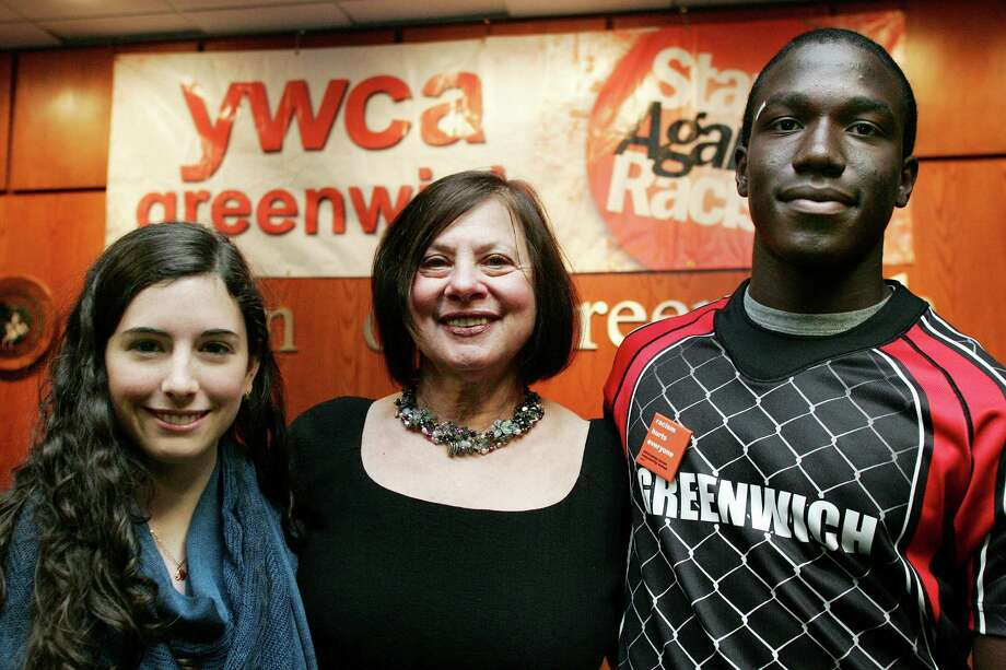 Greenwich High School student Cecillia Cerrillia, left, Adrianne Singer, president and CEO of the YWCA of Greenwich, and Greenwich High School student Gardy Lebon all took part in the YWCA's Stand Against Racism Day at Town Hall Friday, April 27, 2012. Photo: David Ames / Greenwich Time