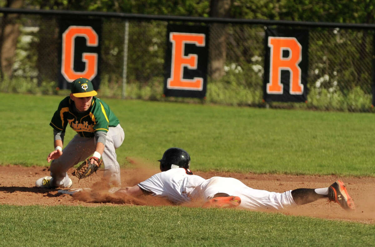 Ridgefield's Bryce Maher is picked off at second by Trinity Catholic's Greg Hajjar during their game at the Old High School Field in Ridgefield, Conn., on Friday, April 27, 2012.