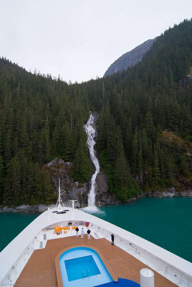 The Disney Wonder noses up to a waterfall in Tracy Arm, a fjord in southwest Alaska. Photo: David Swanson