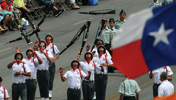 The Robert E. Lee High School R.O.T.C. performs rifle manuevers for parade spectators at the 2012 Battle of Flowers parade on Apr. 27, 2012. Photo: KIN MAN HUI,  Kin Man Hui/Express-News / ©2012 San Antonio Express-News