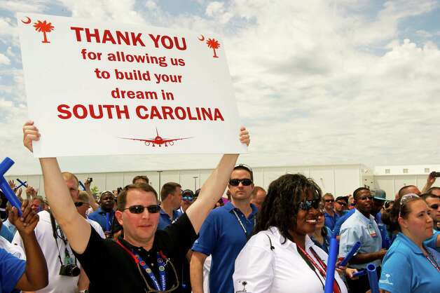 Boeing employees march into the roll out ceremonies on on April 27, 2012 for the first 787 Dreamliner assembled at the Boeing production facilities in North Charleston, S.C. Photo: PAUL J. RICHARDS, AFP/Getty Images / 2012 AFP