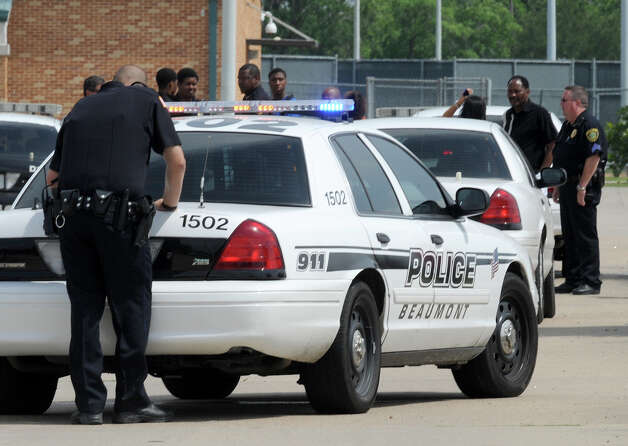 Several Beaumont Police and BISD Police officers responded to Ozen High School Friday after an altercation that stemmed from a water balloon fight. No injuries or arrested were reported. Photo taken Friday, April 27, 2012 Guiseppe Barranco/The Enterprise Photo: Guiseppe Barranco, STAFF PHOTOGRAPHER / The Beaumont Enterprise