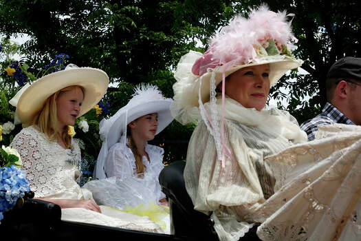 Lee White, (right), Victoria Anderson, 12, (left), and Samantha White, 14, (center), members of Alamo Defenders Descendants Association, wait in their parade car for their turn to join the parade during the Battle of Flowers Parade on April 27, 2012. Photo: BRIA WEBB,  Bria Webb/Special To The Express-News / © 2012 San Antonio Express-News