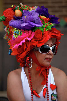 Irma Garcia waits for the Battle of Flowers Parade to begin on Friday, April 27, 2012. Photo: Lisa Krantz, SAN ANTONIO EXPRESS-NEWS / SAN ANTONIO EXPRESS-NEWS