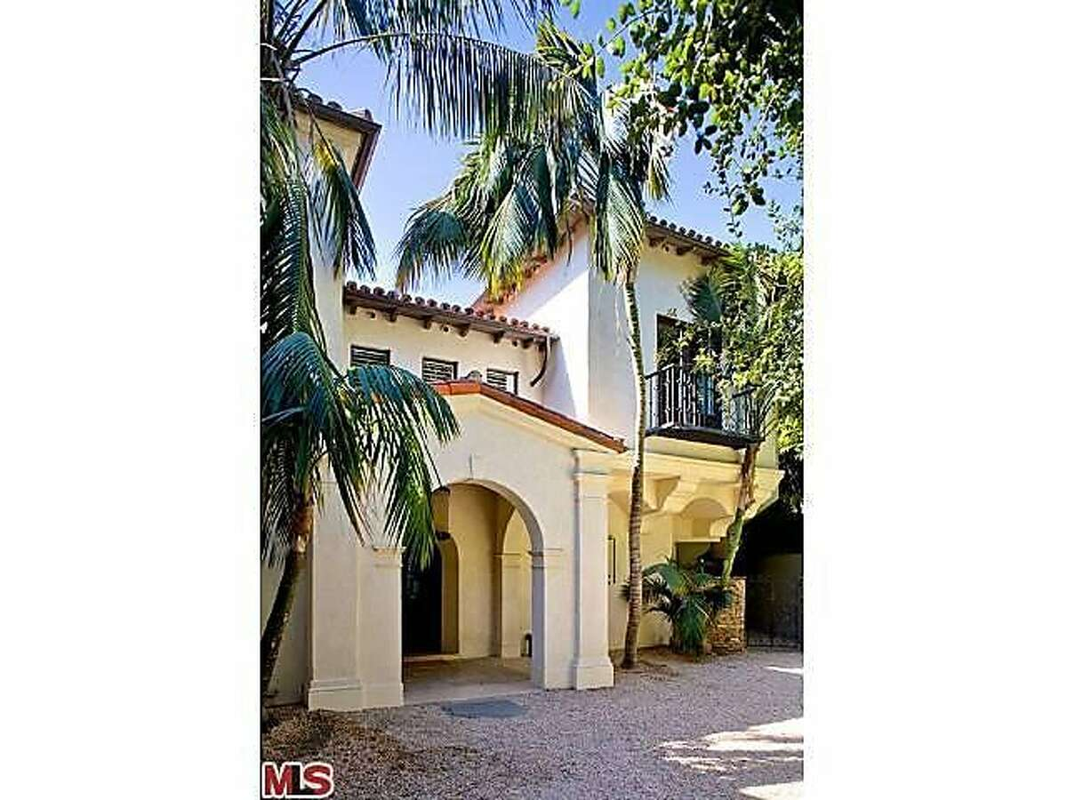 The Spanish-style home offers a motor court and a three-car garage.