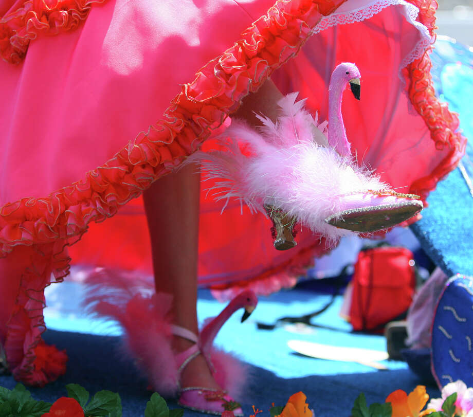 A queen shows her funky flamingo shoes during the Fiesta Battle of Flowers Parade, Friday, April 27, 2012. (JENNIFER WHITNEY) Photo: JENNIFER WHITNEY, SPECIAL TO THE EXPRESS-NEWS / SAN ANTONIO EXPRESS-NEWS