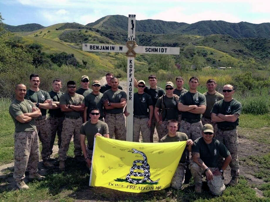 Members of Marine Lance Cpl. Benjamin Whetstone Schmidt's platoon who recently returned from Afghanistan pose at Camp Pendleton, Calif. with a cross they made as a memorial tribute. Placement of religious symbols at the base has been prohibited while the Marine commandant considers the issue in light of a complaint last year by an atheist group. COURTESY PHOTO Photo: COURTESY PHOTO