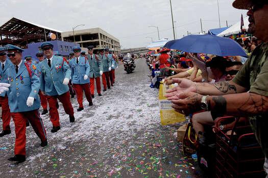 The Texas Cavaliers walk on Broadway during the Battle of Flowers Parade on Friday, April 27, 2012. Photo: Lisa Krantz, SAN ANTONIO EXPRESS-NEWS / SAN ANTONIO EXPRESS-NEWS