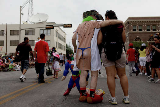 Weldon Albertson, center, celebrates his 44th Fiesta as he poses for pictures with parade goers on Broadway before the Battle of Flowers Parade on Friday, April 27, 2012. Photo: Lisa Krantz, SAN ANTONIO EXPRESS-NEWS / SAN ANTONIO EXPRESS-NEWS