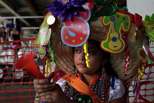 Bertha Escott, 9, waits for the Battle of Flowers Parade to begin on Broadway on Friday, April 27, 2012. Photo: Lisa Krantz, SAN ANTONIO EXPRESS-NEWS / SAN ANTONIO EXPRESS-NEWS