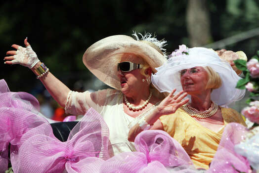 Members of the Women's Club of San Antonio wave at the crowd during the Fiesta Battle of Flowers Parade, Friday, April 27, 2012. (JENNIFER WHITNEY) Photo: JENNIFER WHITNEY, Jennifer Whitney/ Special To The Express-News / special to the Express-News