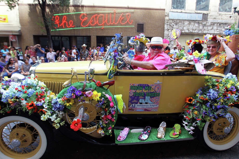The Show Me Your Shoes Assistance League car passes along Commerce St during the Fiesta Battle of Flowers Parade, Friday, April 27, 2012. (JENNIFER WHITNEY) Photo: JENNIFER WHITNEY, Jennifer Whitney/ Special To The Express-News / special to the Express-News