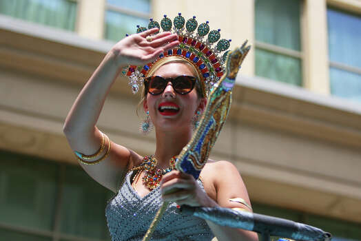 Mary Bell Browning, Duchess of Solar Splendor, waves at the crowd from atop a float during the Fiesta Battle of Flowers Parade, Friday, April 27, 2012. (JENNIFER WHITNEY) Photo: JENNIFER WHITNEY, Jennifer Whitney/ Special To The Express-News / special to the Express-News