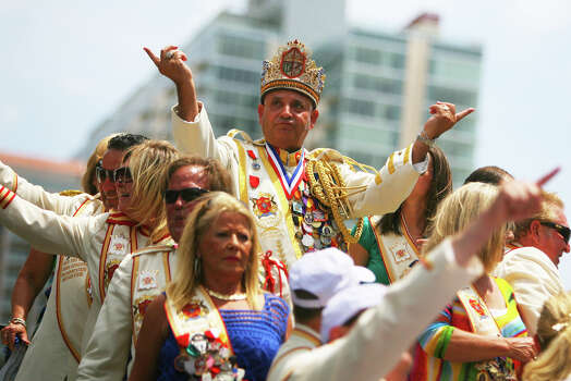 Rey Feo LXIV, Richard Ojeda, waves at the crowd along Commerce St. from atop his float during the Fiesta Battle of Flowers Parade, Friday, April 27, 2012. (JENNIFER WHITNEY) Photo: JENNIFER WHITNEY, Jennifer Whitney/ Special To The Express-News / special to the Express-News