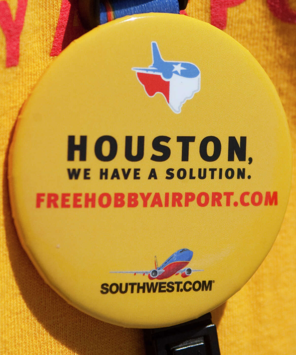 Southwest Airlines employees wore shirts and buttons in support of a new international flight station during the Hobby Fest at Hobby Airport on Saturday, April 21, 2012 in Houston, TX. ( J. Patric Schneider / For the Chronicle )