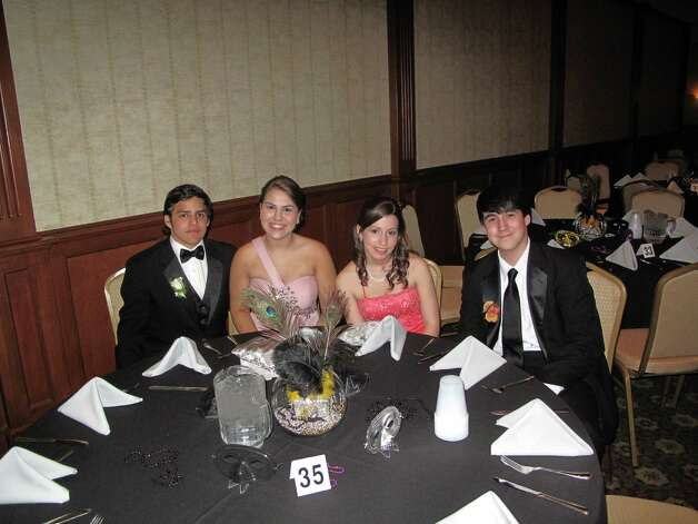 From left to right: Oscar Borjas, Margie Haha, Amanda Garay and Evan Rosoff enjoying each other's company at table 35. Photo: Paresh Jha