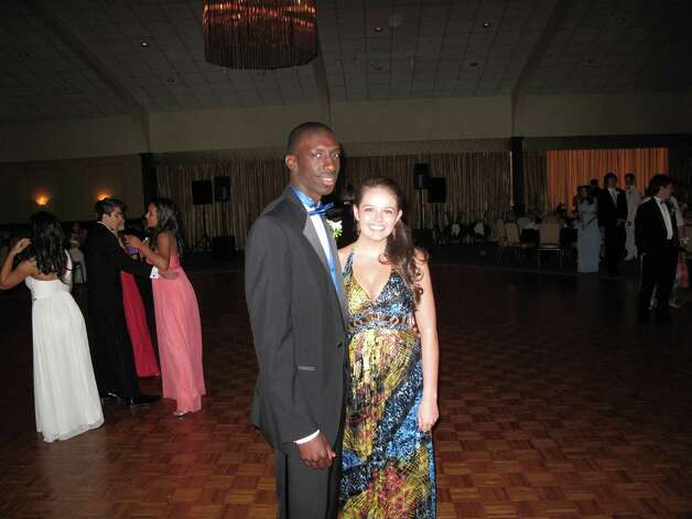 Devaun Bovell and his date Shea Durkin pose for a photo near the dance floor. Photo: Paresh Jha