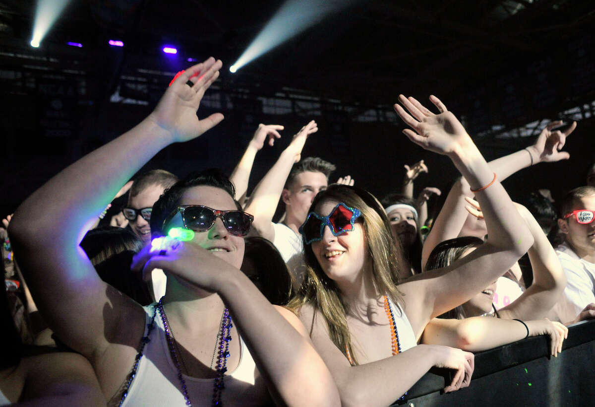 Jes D'Andrea, left, and Christina Zendman listen to the DJ Apollo V at Dayglow