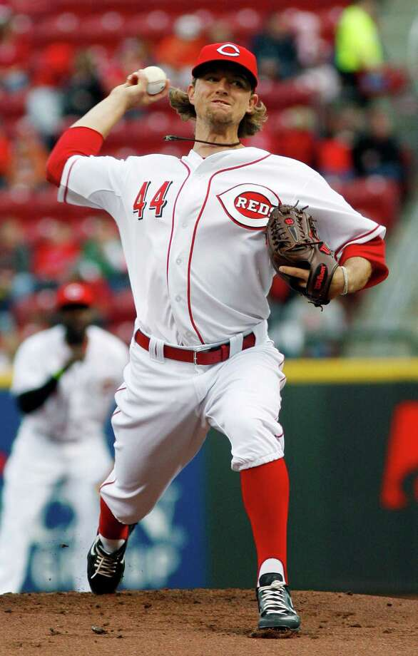 Cincinnati Reds starting pitcher Mike Leake (44) throws against the Houston Astros during the first inning of a baseball game, Friday, April 27, 2012, in Cincinnati. (AP Photo/David Kohl) Photo: DAVID KOHL, Associated Press / FR51830 AP