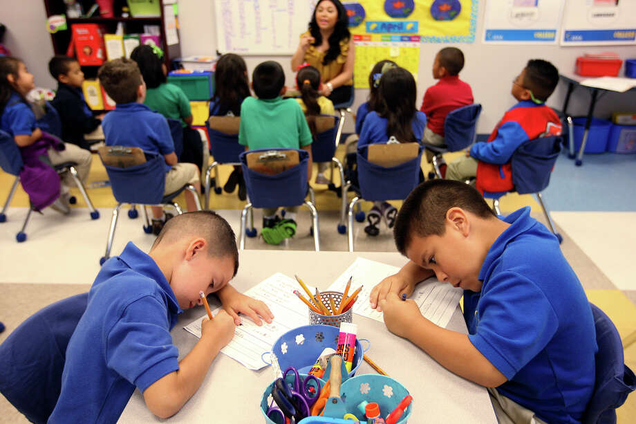 Jose Angel Luna, left, and Alejandro Fernandez concentrate on their task during a kinder english classes at Weslaco IDEA Public Schools, Wednesday, April 11, 2012. Photo: JERRY LARA, San Antonio Express-News / SAN ANTONIO EXPRESS-NEWS