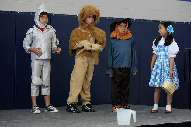 "Students rehearse for ""The Wizard of Oz,"" at Weslaco IDEA Public Schools, Wednesday, April 11, 2012. Photo: JERRY LARA, San Antonio Express-News / SAN ANTONIO EXPRESS-NEWS"