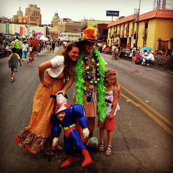 Weldon Albertson poses for pictures before the Battle of Flowers Parade on Friday, April 27, 2012. Albertson has been attending Fiesta for over 40 years. Photo made with iPhone 4 and processed with Instagram filters. Photo: Lisa Krantz, San Antonio Express-News / SAN ANTONIO EXPRESS-NEWS