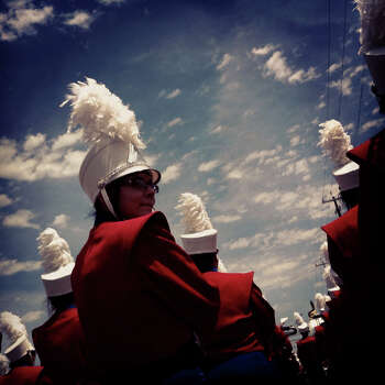 The Jefferson High School band enters the parade route during the Battle of Flowers Parade on Friday, April 27, 2012. Photo made with iPhone 4 and processed with Instagram filters. Photo: Lisa Krantz, San Antonio Express-News / SAN ANTONIO EXPRESS-NEWS