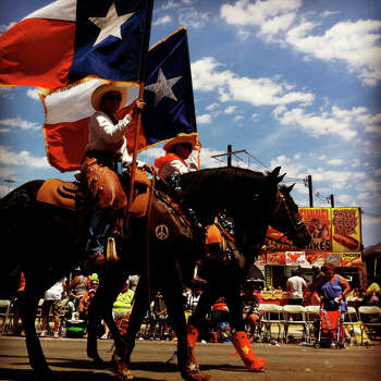 Women with the Guadalupe County Fair Association from Seguin ride horses in the Battle of Flowers Parade on Friday, April 27, 2012. Photo made with iPhone 4 and processed with Instagram filters. Photo: Lisa Krantz, San Antonio Express-News / SAN ANTONIO EXPRESS-NEWS