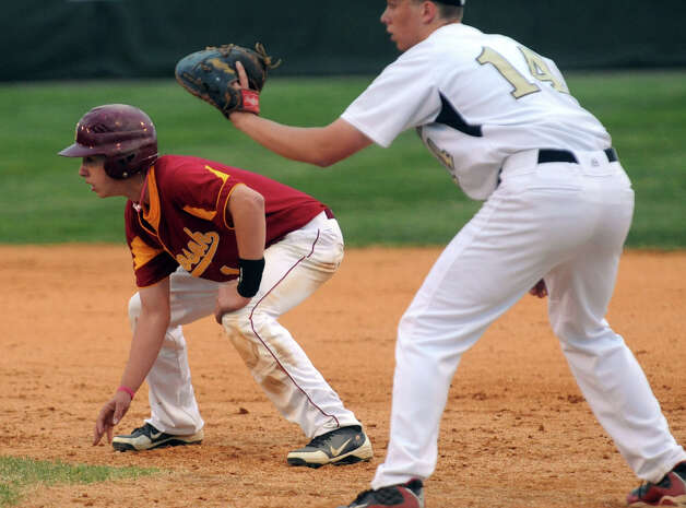 St. Joseph's #1 Matt Batten, left, during baseball action against Trumbull in Trumbull, Conn. on Friday April 20, 2012. Photo: Christian Abraham / Connecticut Post