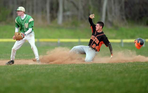 Shelton's Marcello Ursini slides to second base ast Notre Dame-West Haven's Brian Rhone waits for the ball during their baseball game Wednesday, April 11, 2012 at Shelton High School. Photo: Autumn Driscoll / Connecticut Post