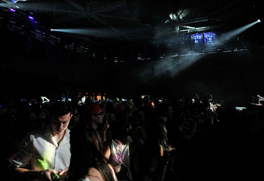 "Scenes at Dayglow ""World's Largest Paint Party"" at Western Connecticut State University's westside campus in Danbury, Conn., on Friday, April 27, 2012. Photo: Jason Rearick / The News-Times"