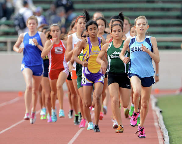 Johnson's Natalie Langan (right) broke a 28-year-old meet record in the 3,200-meter run at Friday's Region IV-4A/5A meet with a time of 10:41.51. Photo: John Albright, For The Express-News