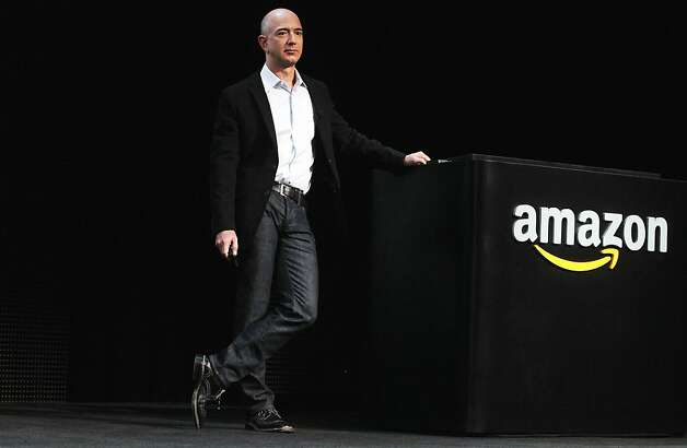 "Amazon just  topped Apple to become the nation's most highly-regarded  high-profile  company. The Harris ""Reputation Quotient"" looks at social   responsibility, emotional appeal, financial performance, products and   services, vision and leadership, and workplace environment. Amazon   notched a score of 82.62, up from 81.92 last year. It was the top scorer   in emotional appeal and products and services, finished in the top  five  in five of the six areas, and ""receives nearly 100 percent  positive  ratings on all measures related to trust and tremendous  support in  Advocacy and Word of Mouth,"" according to Harris. Click on  to see where  other Washington companies ranked. Photo: Spencer Platt, Getty Images"