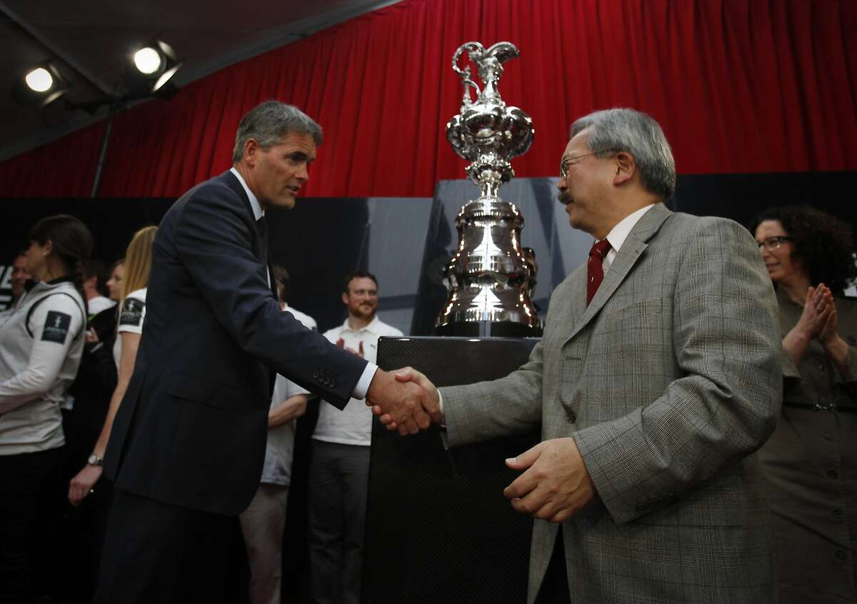 Sir Russell Coutts (l to r) and Mayor Ed Lee shake hands after at the conclusion of a celebration of the upcoming America's Cup races and after Mayor Lee's ceremonial signing of an agreement to bring the America's Cup races to San Francisco in 2013 at Pier 27 on Friday, April 27, 2012 in San Francisco, Calif.