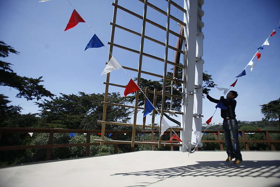 Kasing Shum San Francisco Recreation and Parks stationary engineer works next to the sails of the Dutch Windmill while making preparations for the Queen's Day festival on Friday, April 27, 2012 in San Francisco, Calif. Photo: Lea Suzuki, The Chronicle