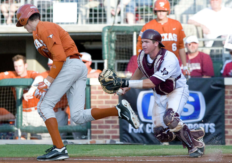Texas A&M catcher Troy Stein, right, scrambles to catch up as Texas hitter Taylor Stell tries to make it to first on a passed ball during the first inning. Photo: Stuart Villanueva / Bryan College Station Eagle