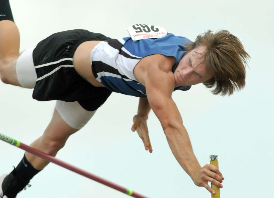 Brazoswood senior Connor McGuire goes up for his attempt at 15 feet, 9 inches during pole vault competition at the 5A Region III track and field event Friday. Photo: Jerry Baker