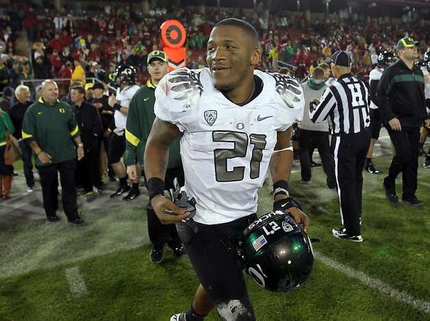 LaMichael James #21 of the Oregon Ducks runs onto the field after they beat the Stanford Cardinal at Stanford Stadium on November 12, 2011 in Stanford, California. Photo: Ezra Shaw, Getty Images