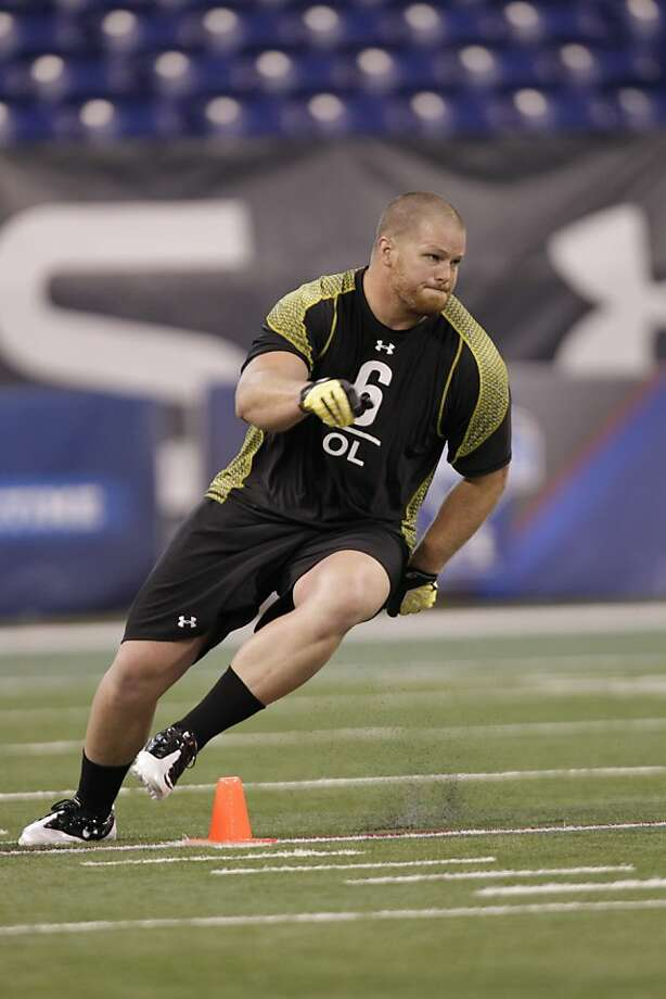 Utah offensive lineman Tony Bergstrom runs a drill at the NFL football scouting combine in Indianapolis, Saturday, Feb. 25, 2012. Photo: Michael Conroy, ASSOCIATED PRESS