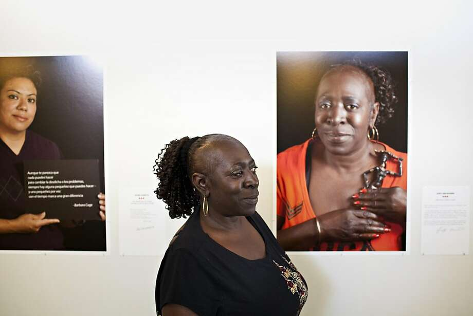 "Judy Crawford, who works at the HPP, poses in front of a photograph of herself taken by Marsha Guggenheim from the exhibit, ""Facing Forward,"" at the Homeless Prenatal Program in San Francisco, Calif., Thursday, April 26, 2012. The exhibit depicts 28 women who came from homelessness and despair, and in a yearlong course at the program learned how to become social workers.   Jason Henry/Special to The Chronicle Photo: Jason Henry, Special To The Chronicle"