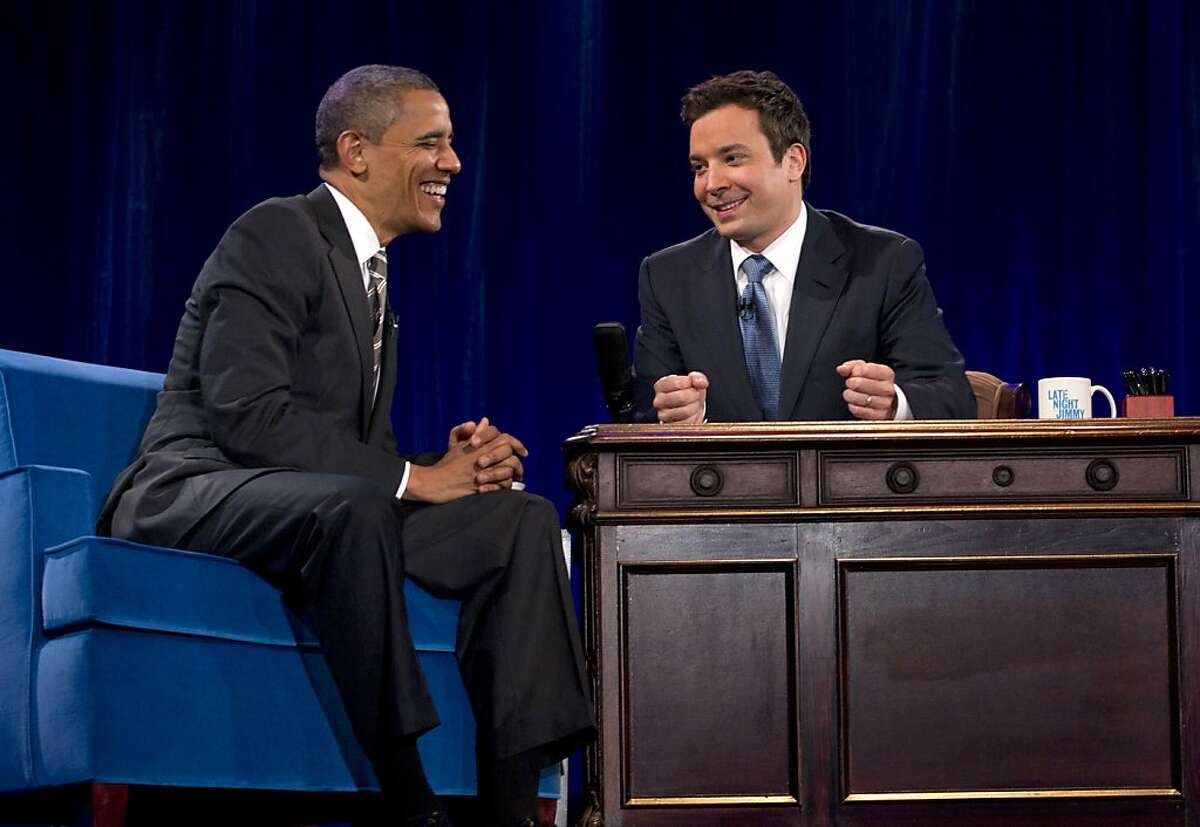 President Barack Obama talks with Jimmy Fallon during commercial break as he participates in a taping of the Jimmy Fallon Show, Tuesday, April 24, 2012, at the University of North Carolina at Chapel Hill, N.C..