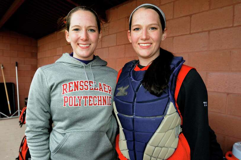 Guilderland's Morgan Ten Eyck, left, and her twin Taylor in the dugout during their softball game ag