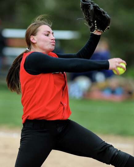 Guilderland's Mallory Harringan winds up the pitch during their softball game against Averill Park o