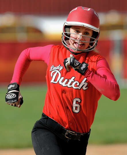 Guilderland's Jenna Cubello(6) runs the bases when she hits a triple during their softball game agai