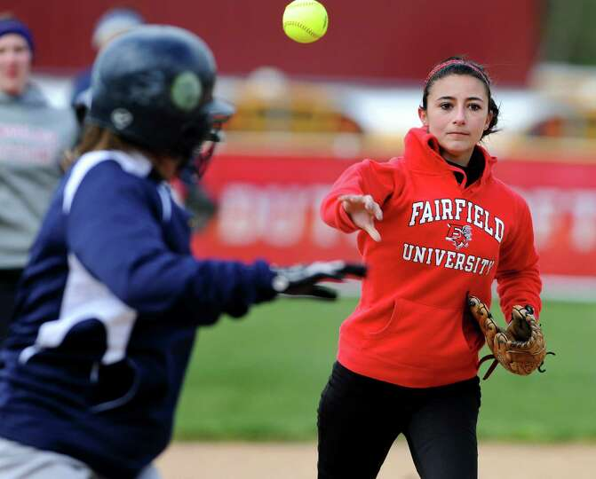 Guilderland's second baseman Tori Greco, right, helps with a rundown between second and third during