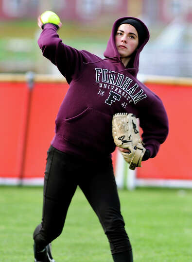 Guilderland's Kelsey O'Connor throws in a catch from left field during their softball game against A