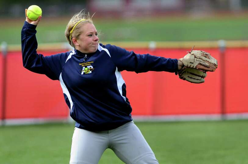 Averill Park's Cara Danish throws in a catch from the left field during their softball game against