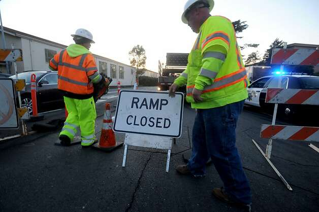 A worker closes Doyle Dr. on Friday, April 22, 2012, in San Francisco. Photo: Noah Berger, Special To The Chronicle