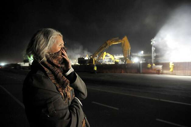 Skye Czember watches as workers demolish Doyle Dr. on Friday, April 22, 2012, in San Francisco. Czember, whose ex-husband died when the Cypress Freeway collapsed on his vehicle in 1989, said she was moved to know that Doyle Drive would not longer pose a seismic hazard. Photo: Noah Berger, Special To The Chronicle